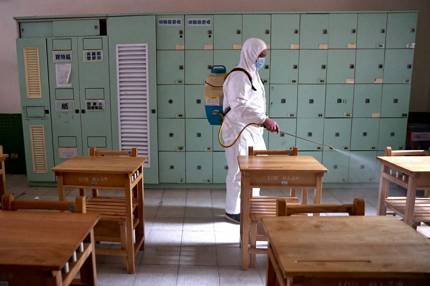 A worker disinfecting a school in Taipei on May 16, 2021.