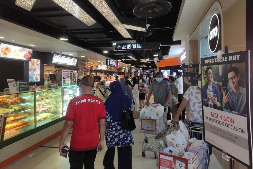 Shoppers at basement level in Tampines Mall on May 17, 2021.
