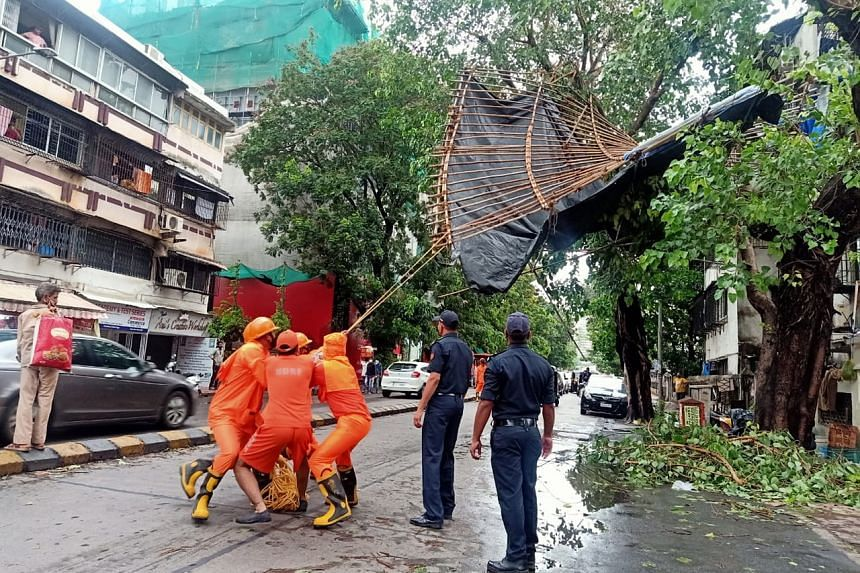 India's National Disaster Response Force clearing a road after Cyclone Tauktae hits Mumbai, on May 18, 2021.