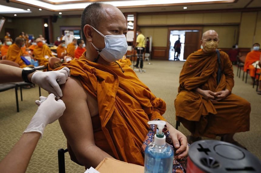 A Thai monk receiving the Sinovac vaccine during a vaccination drive in Bangkok on May 18, 2021.