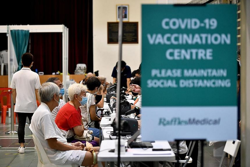 Seniors getting vaccinated in March. Singapore's moderately high vaccination rate of over 30 per cent of the population is a game changer in helping the nation avoid another circuit breaker, says Professor Dale Fisher. ST PHOTO: LIM YAOHUI