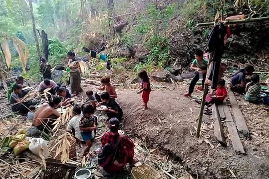 Displaced people from the north-western town of Mindat taking shelter in a forest in Myanmar's Chin state, on Thursday.