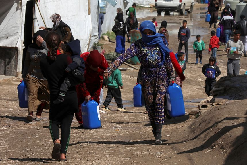 Syrian refugees at an informal tented settlement in the Bekaa valley in Lebanon on March 12, 2021.