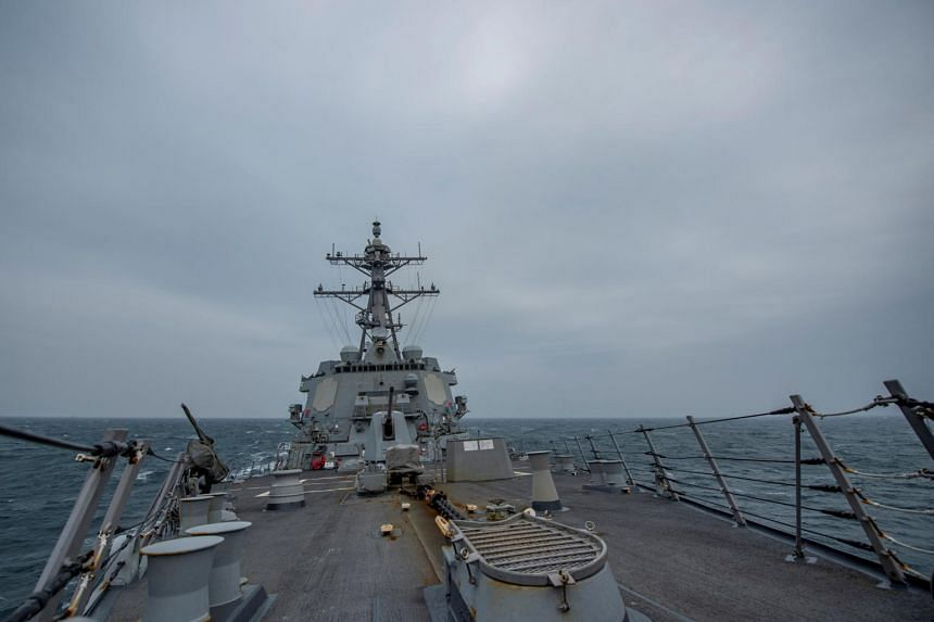 US Navy Arleigh Burke-class guided-missile destroyer USS John Finn transits the Taiwan Strait March 10, 2021.