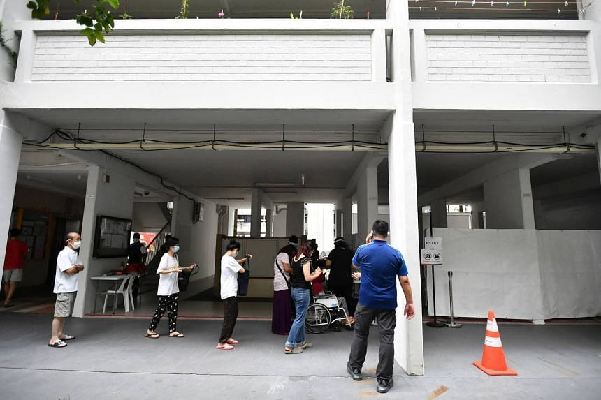 Residents queueing for Covid-19 swab testing at Block 506 Hougang Avenue 8 on May 21, 2021.