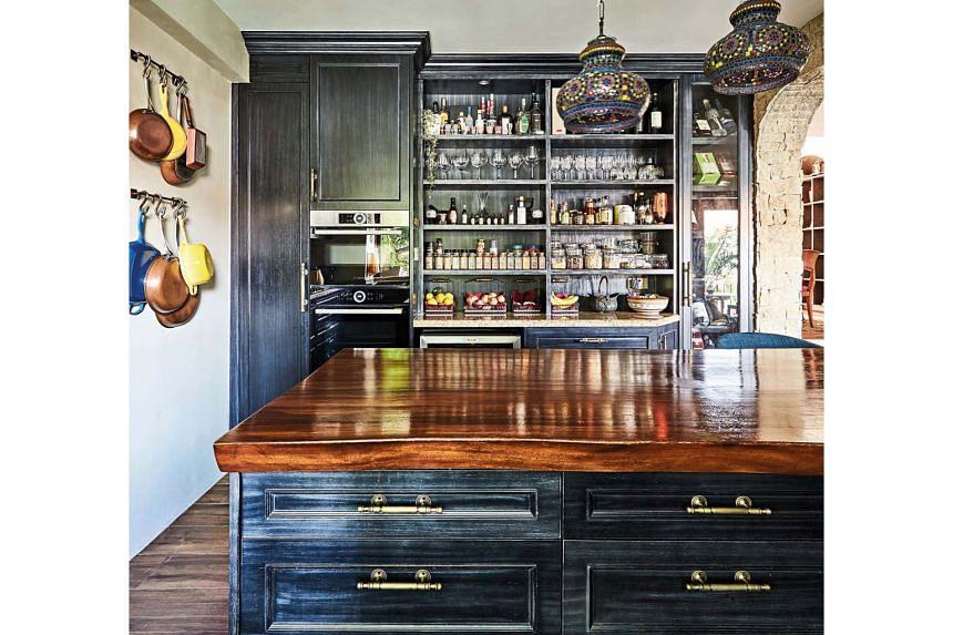 A kitchen island with a custom-fit suar wood slab.