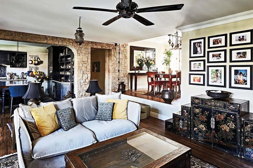 Imperfect edges and layered textures give the home character. Every stone on the living room wall is from a boulder cut and shaped by an artisan. (From far left) A kitchen island with a custom-fit suar wood slab; the master bedroom, which features a
