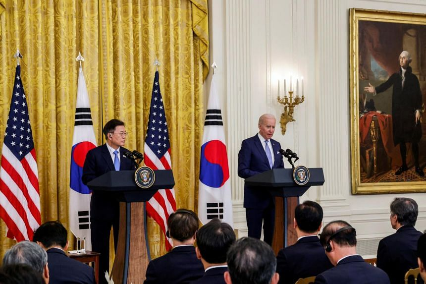 South Korean President Moon Jae-in (left) and US President Joe Biden at a joint news conference at the White House, on May 21, 2021.