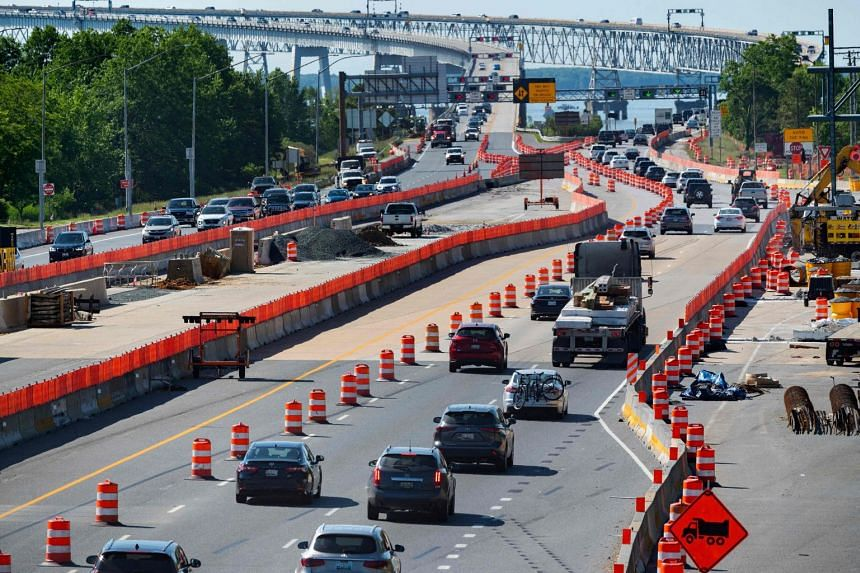 Traffic flows through a construction area near the Bay Bridge in Annapolis, Maryland, in the US, on May 21, 2021.