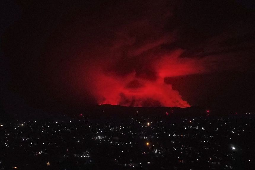 Nyiragongo, one of the world's most active volcanoes, erupted in the early evening on Saturday, tinging the sky above Goma.