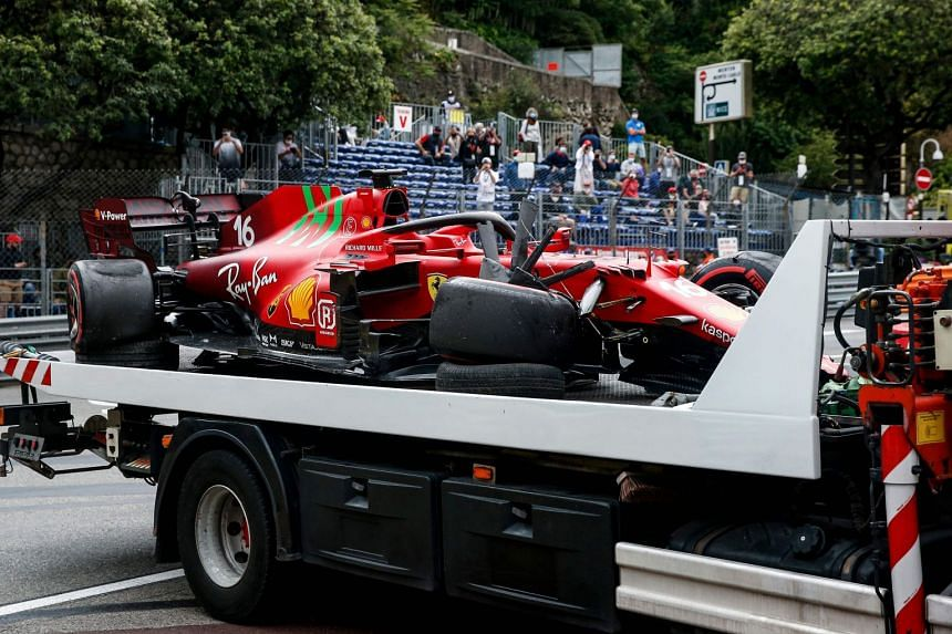 A truck carries off the damaged car of Ferrari's Charles Leclerc after the Monaco grand prix qualifying session.