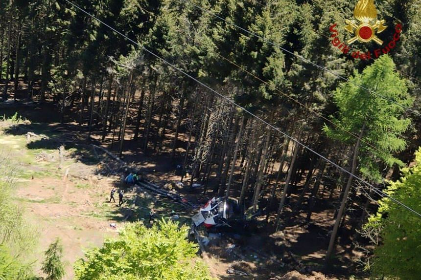 """The cable car had fallen from very high and was now sitting, """"crumpled"""" in the woods below, a spokesman said."""