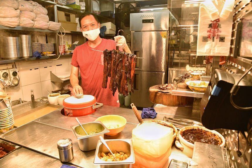 Mr Khong Wai Keong, who sells char siew rice at Kovan Hougang Market and Food Centre.