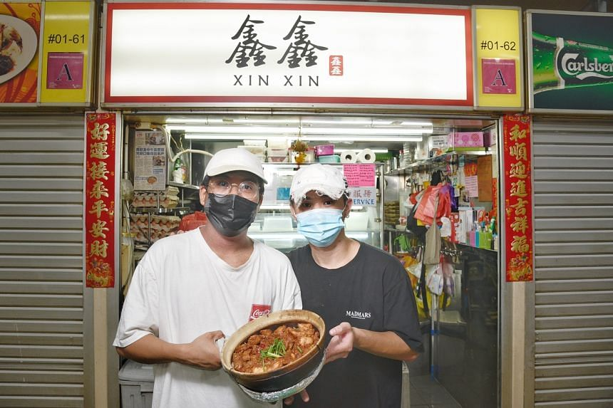 Mr Will Chua (left) and Mr Damien Foo, co-owners of a claypot chicken rice stall at Kovan Hougang Market and Food Centre.
