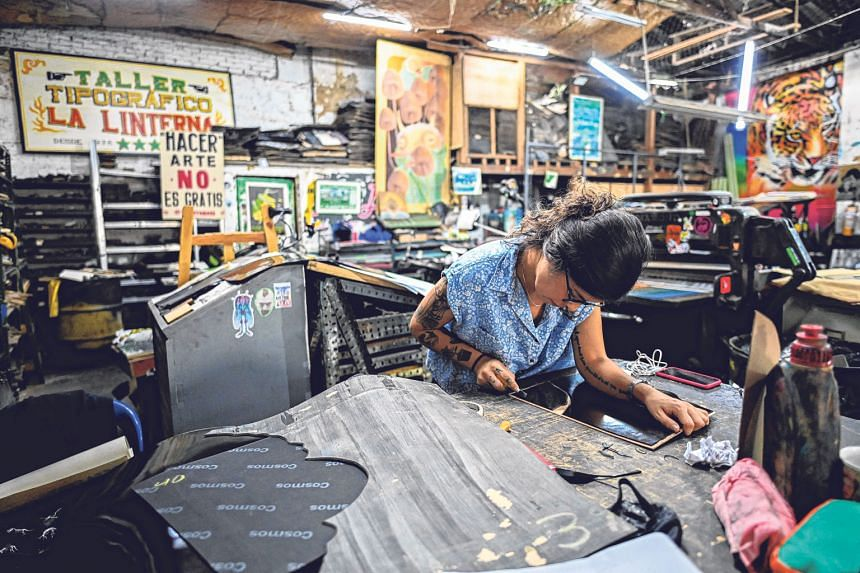 Founded to print newspapers, the press (above) also produced concert posters for artistes such as British singer Elton John. Today, it prints urban art such as those by Colombian artists Tonra (far left) and Lili Cuca (left). Mr Jaime Garcia, one of