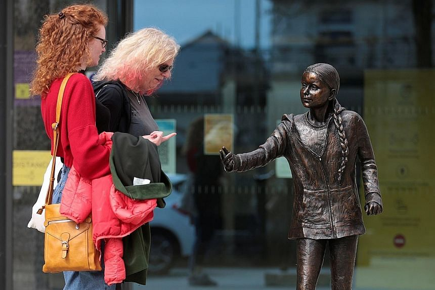 A statue of Ms Greta Thunberg at Winchester University in Britain. The climate activist aims to change how the world produces and consumes food in order to counteract the threats of carbon emissions, disease outbreaks and animal suffering. PHOTO: REU