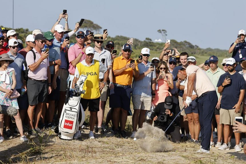 Brooks Koepka hits from the edge of the gallery during the final round of the PGA Championship at Kiawah Island, South Carolina, on May 23, 2021.