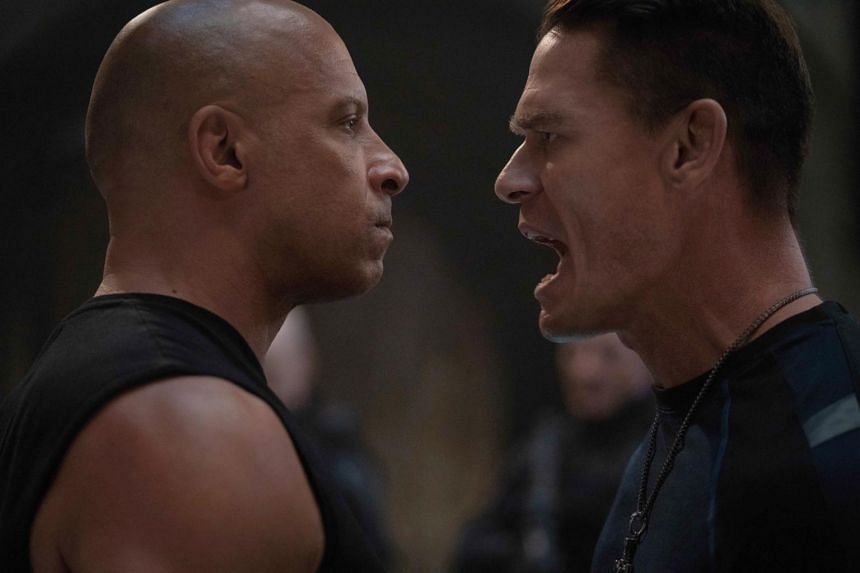 F9 is directed by Justin Lin and stars Vin Diesel (left), Michelle Rodriguez and John Cena (right).