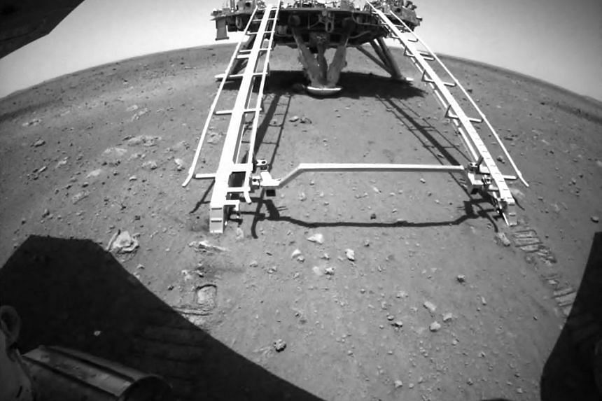 China's Zhurong Mars rover of the Tianwen-1 mission driving down from its landing platform onto the surface of Mars earlier this month.
