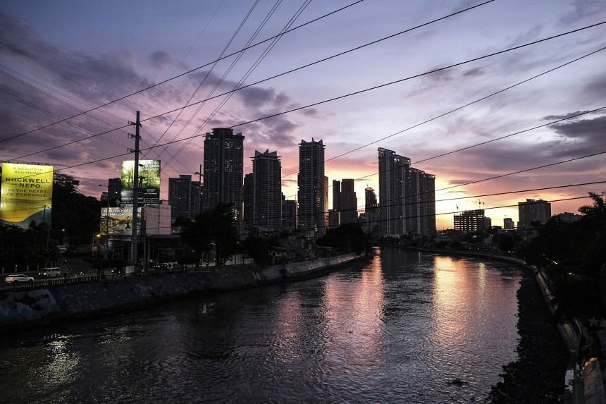 Buildings along the Pasig River during dusk in Metro Manila on May 11, 2021.