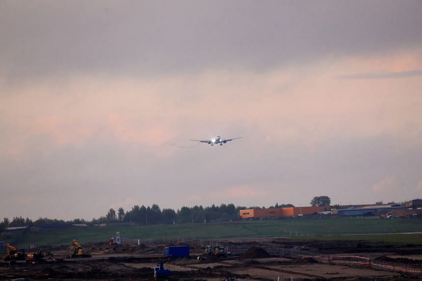 A plane approaches to land in the Vilnius International Airport, in Vilnius, Lithuania, on May 23, 2021.