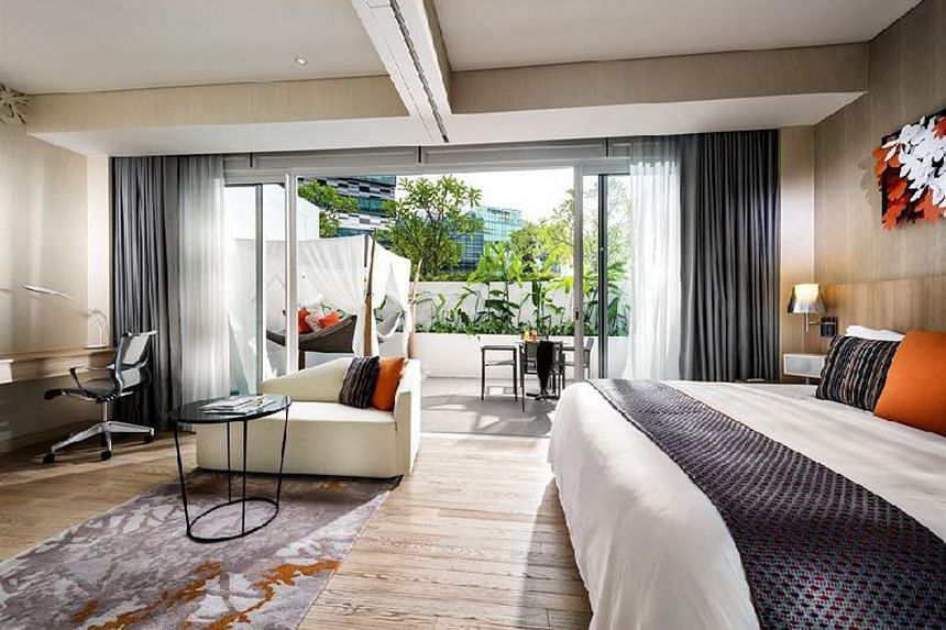Guests stay in rooms styled like apartment studios.