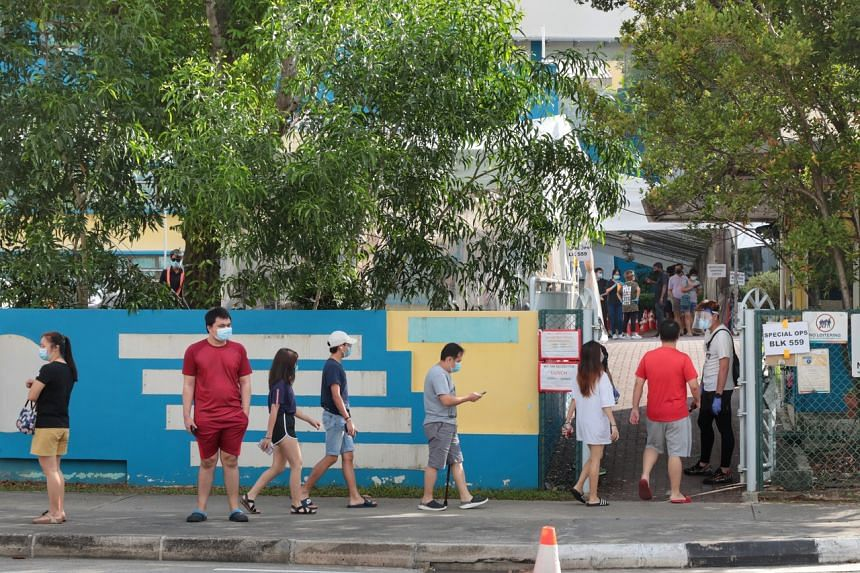 People arriving for their Covid-19 test at the former Coral Primary School on Sunday.