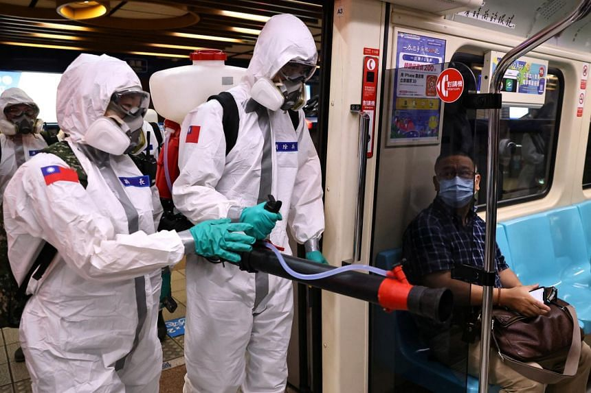 Soldiers disinfect a metro station in Taipei on May 25, 2021.