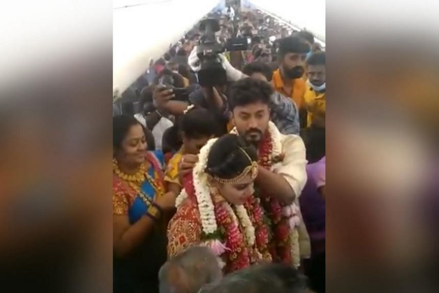 A video of on-board celebrations posted on social media show people with flowers around their necks and taking selfies.