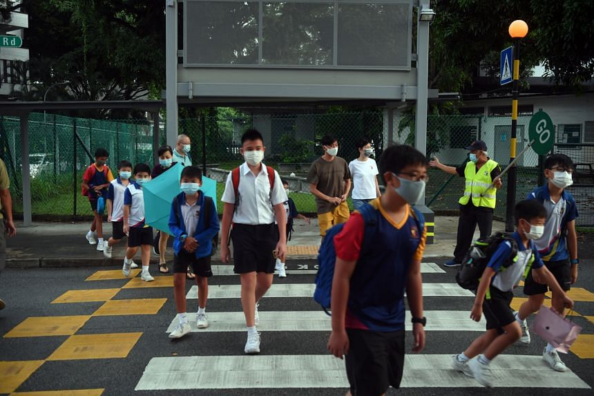 Students from Anglo-Chinese School (Junior) going to school on May 18, 2021.