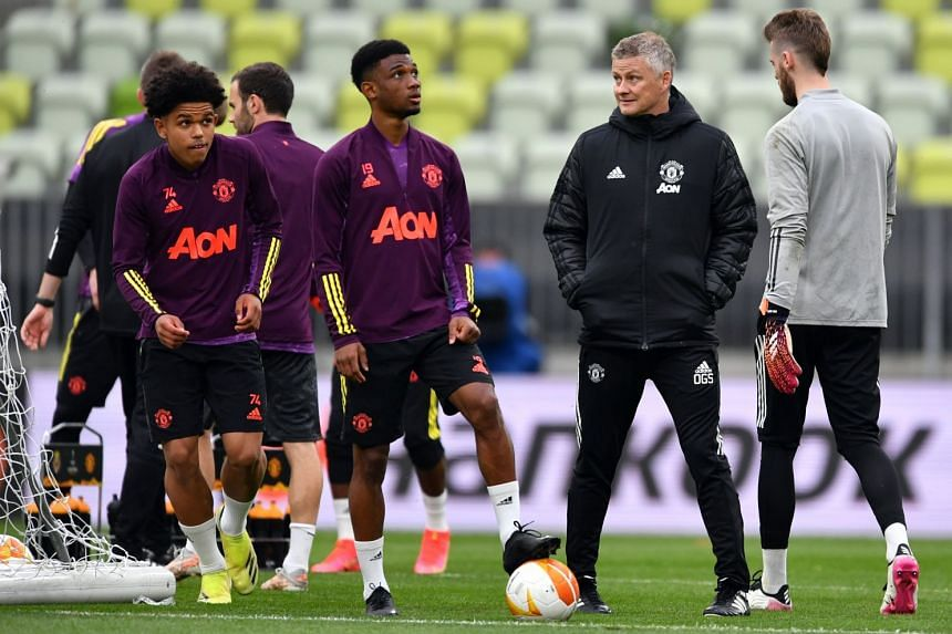 United manager Ole Gunnar Solskjaer (second right) during the club's taining session in Gdansk, Poland..