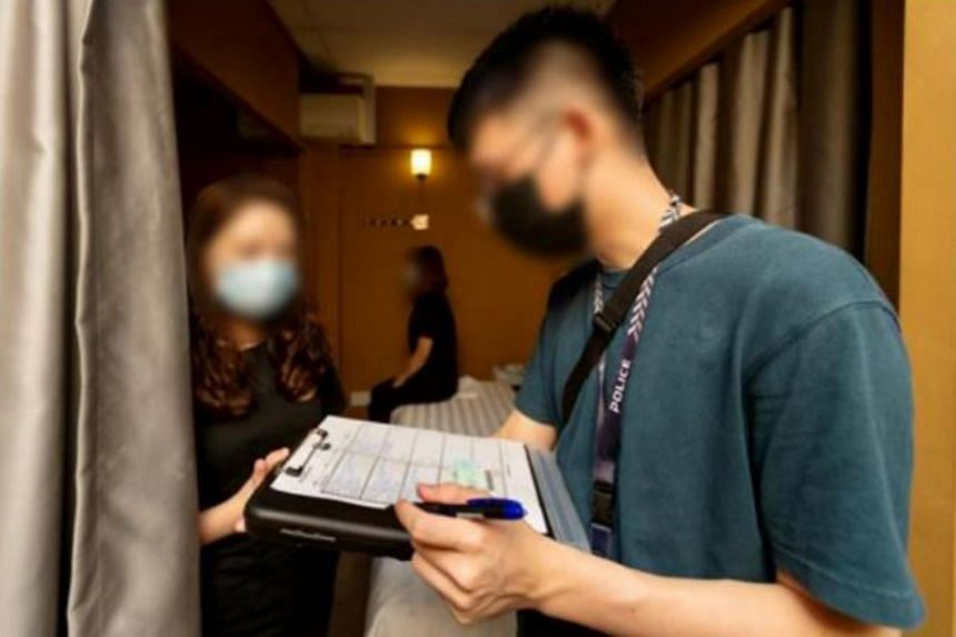 Police officers stepping up checks at massage establishments to ensure operators and customers comply with safe distancing measures.