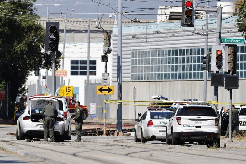 Police and investigators at the scene of the workplace shooting in San Jose, California.