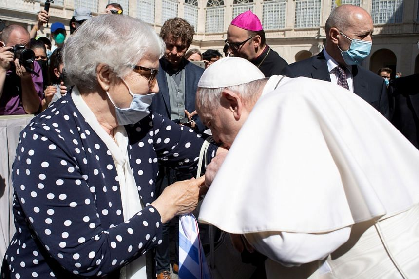 Pope Francis greets Holocaust survivor Lidia Maksymowicz and kisses a concentration camp number tattooed on her arm.