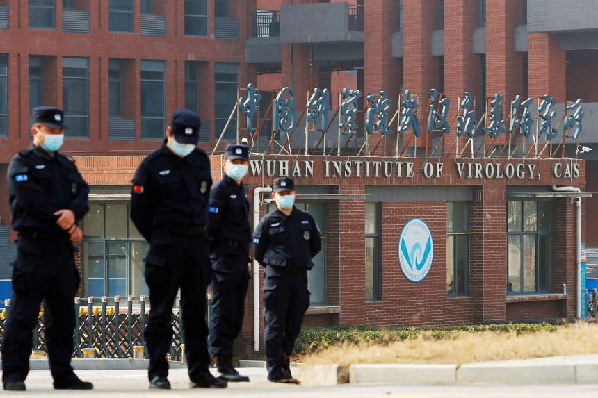 Security personnel keeping watch outside the Wuhan Institute of Virology during a visit by a World Health Organisation team in February 2021.