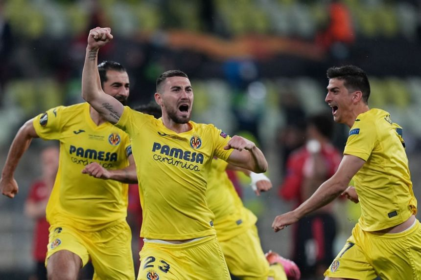 Villarreal's Moi Gomez celebrates with teammates after winning the Europa League.