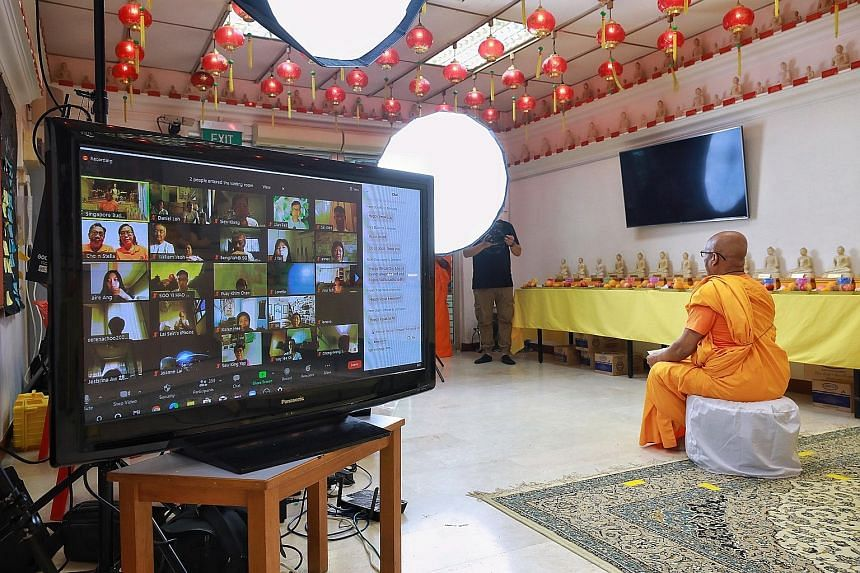 Venerable K. Dhammika Maha Thera, chief monk of the Singapore Buddhist Mission, addressing devotees taking part in the mass online meditation session to mark Vesak Day yesterday. The event included an online concert featuring more than 10 Buddhist mu