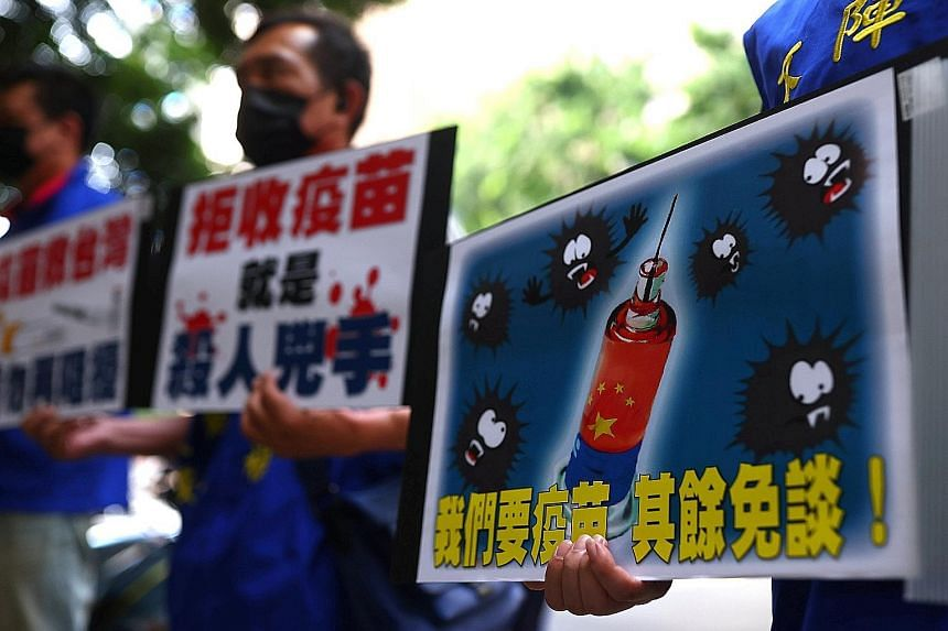 Protesters calling for the Taiwanese government to allow the use of Covid-19 vaccines from China, on Monday. Taiwan has rejected China's vaccines, saying Beijing has not provided adequate information about its shots.