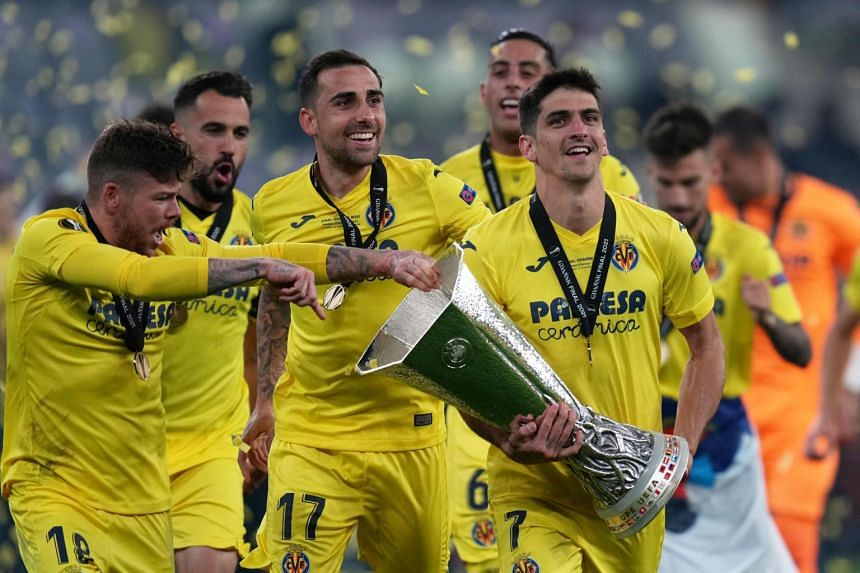 Villarreal's Spanish forward Gerard Moreno (right) celebrates with the trophy after winning the Uefa Europa League final.