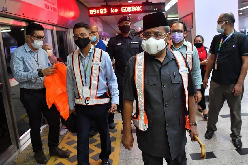 Datuk Seri Tajuddin Abdul Rahman (middle) visiting the site of an accident involving two LRT trains in Kuala Lumpur on May 26, 2021.