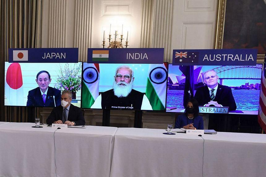 Quad leaders (from left) Yoshihide Suga, Narendra Modi and Scott Morrison listen during a virtual meeting with US President Joe Biden.
