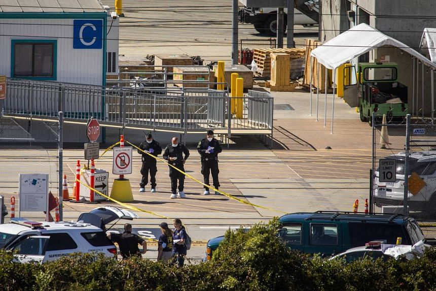 Investigators work at the scene of a mass shooting at the Valley Transportation Authority light-rail yard, on May 26, 2021.