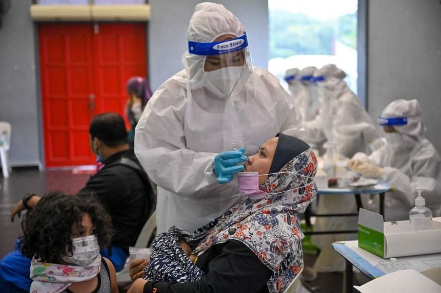 A medical worker conducts a test at a free Covid-19 testing site in Shah Alam, on May 27, 2021.