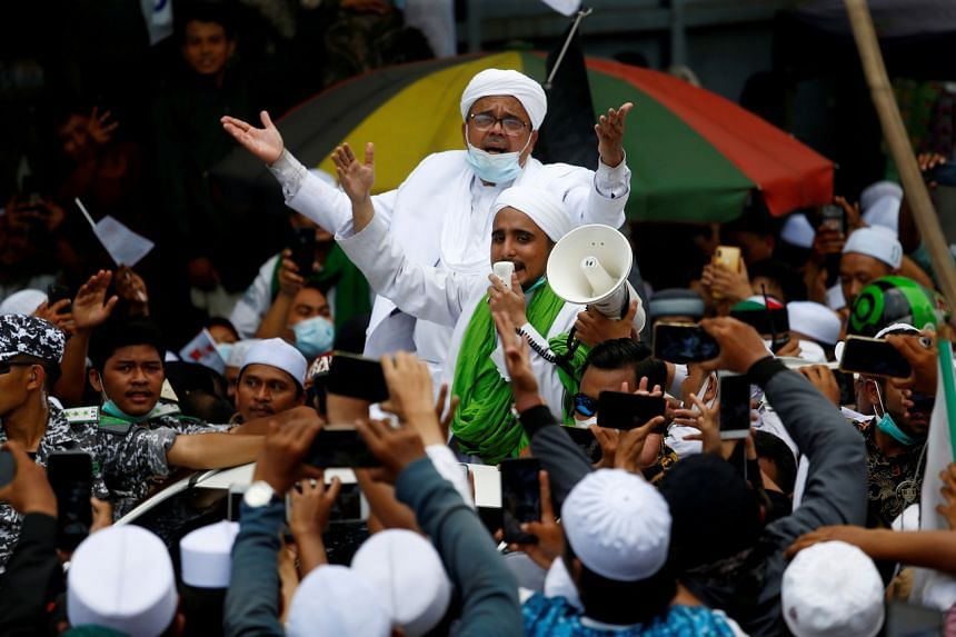Muslim cleric Rizieq Shihab (top) was handed the prison term for violating the health quarantine law.