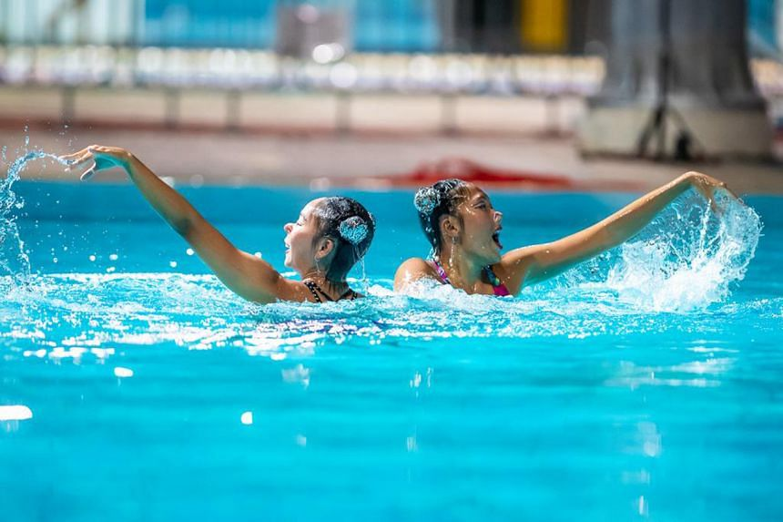Miya Yong (left) and Debbie Soh perform a routine during a closed-door performance at Toa Payoh Swimming Complex.