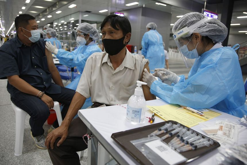 A Thai man getting his vaccination at the Bang Sue Grand Station in Bangkok on May 24, 2021.