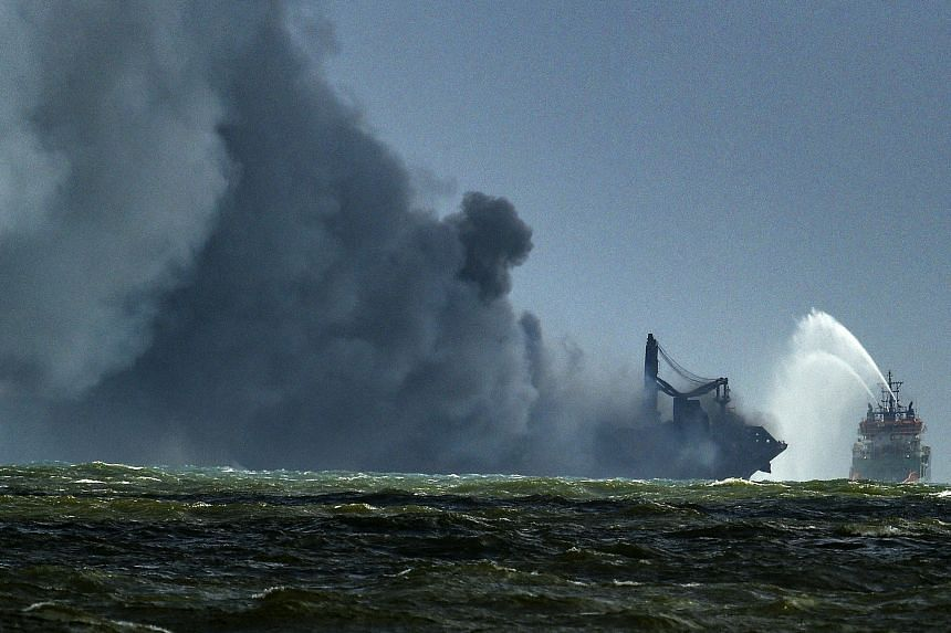 A Sri Lankan Navy ship trying to douse the fire on board the container ship MV X-Press Pearl, in the sea off Colombo Harbour on May 27, 2021.