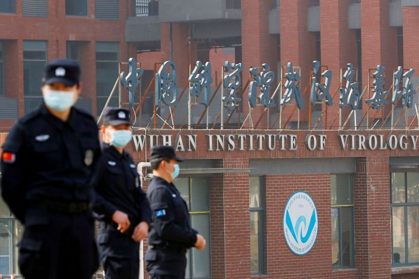 Security personnel keep watch outside the Wuhan Institute of Virology, during a visit by a World Health Organisation team tasked with investigating the origins of coronavirus, in February 2021.