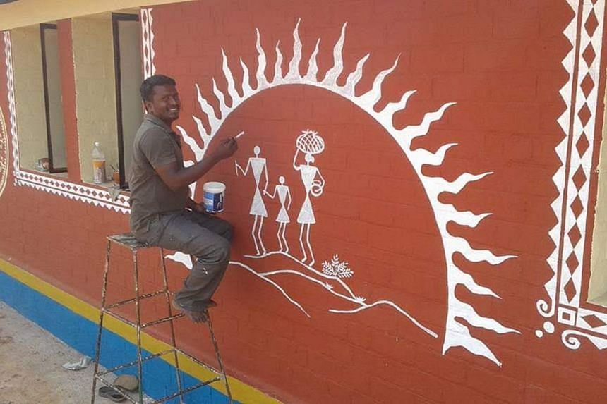 Mr Nanjundasamy M. working on a community mural for a sustainable farming collective called Amrita Bhoomi – the Evergreen Earth.