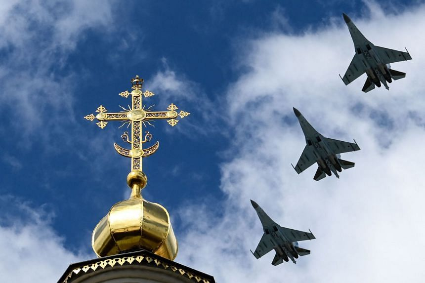 Russian Sukhoi Su-34 fighter-bombers fly over downtown Moscow during a rehearsal for a World War II Victory Parade on May 5, 2021.